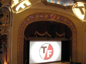 photo of stage at Missouri Theater with True/False logo projected on screen