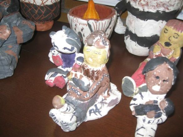 photo of clay storyteller dolls made by schoolchildren